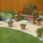 Shaped seating area in natural sandstone with tumbled block edging